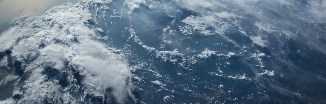 Macro view of white clouds onto of a blue planet